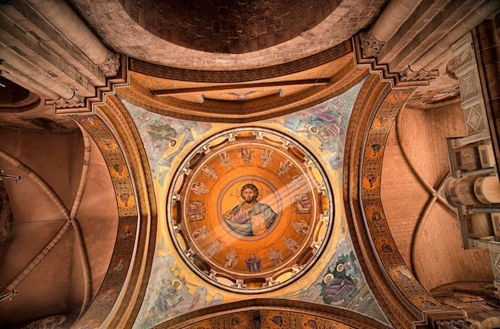 "The inner dome of the Greek Orthodox Catholicon inside the Church of the Holy Sepulchre, directly above ""the omphalos"", once believed by Christians to mark the navel of the world"