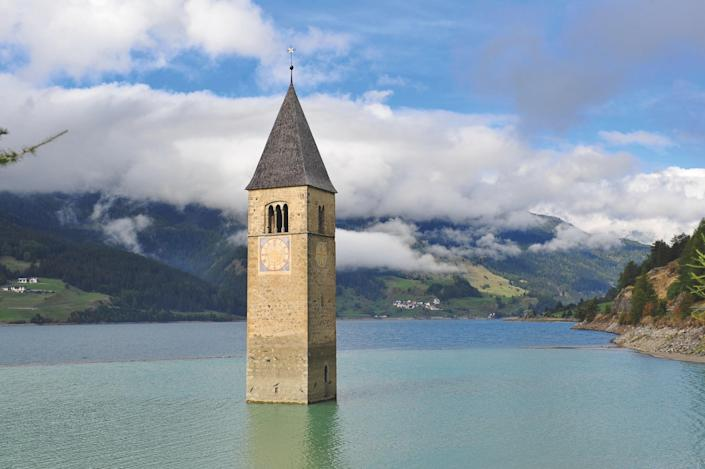 "The church's 1355 spire rises out of the water of a lake, creating a beautiful image with a dark backstory. In 1950, families living in Reschensee were displaced when their village was deliberately flooded to create this reservoir. ""Mussolini planned the lake or reservoir just before or during World War II; yet post-fascist rulers completed the arguably insensitive project,"" says Joffe. ""Architecturally this 1355 spire is a simple yet elegant structure. That it stands at all is a credit to its medieval builders."""