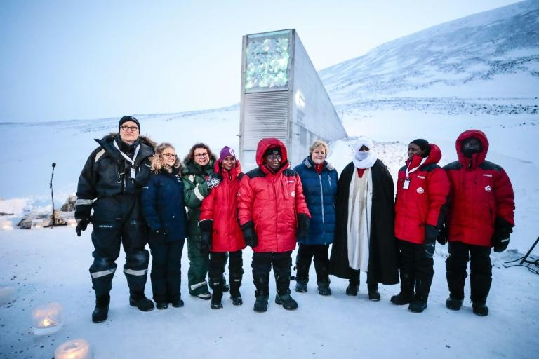 Norway's Prime Minister Erna Solberg, fourth from the right, and other representatives outside the vault