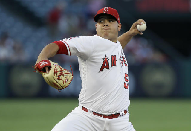 Los Angeles Angels starting pitcher Jose Suarez throws to a Pittsburgh Pirates batter during the first inning of a baseball game in Anaheim, Calif., Monday, Aug. 12, 2019. (AP Photo/Alex Gallardo)