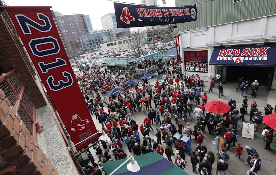 Fans enter Fenway Park on Yawkey Way before a Boston Red Sox home game. (AP)