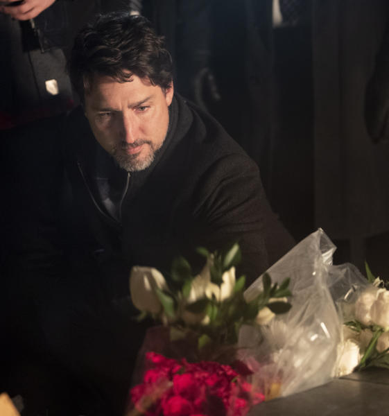 Canadian Prime Minister Justin Trudeau participates in a candlelight vigil to remember the victims of the Ukraine International Airlines plane crash, Thursday, Jan. 9, 2020, in Ottawa, Ontario. The civilian Ukrainian jetliner crashed near Tehran late Tuesday, killing all 176 people on board. (Adrian Wyld/The Canadian Press via AP)