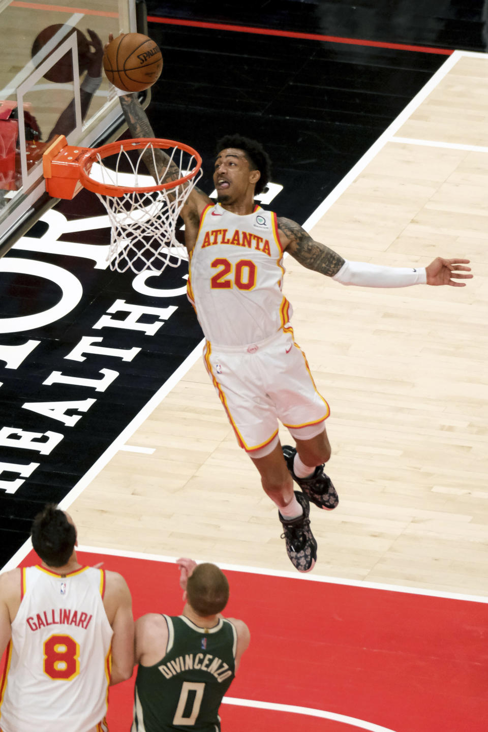 Atlanta Hawks forward John Collins (20) dunks the ball during the second half of an NBA basketball game against the Milwaukee Bucks, on Sunday, April 25, 2021, in Atlanta. (AP Photo/Ben Gray)