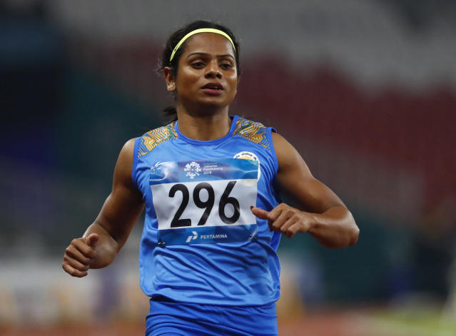 India's Dutee Chand reacts after her heat of the women's 100m during the athletics competition at the 18th Asian Games in Jakarta, Indonesia, Saturday, Aug. 25, 2018. (AP Photo/Bernat Armangue)