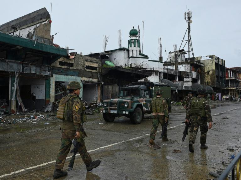 Philippine soldiers last week patrolled the ruined streets as fighting abated