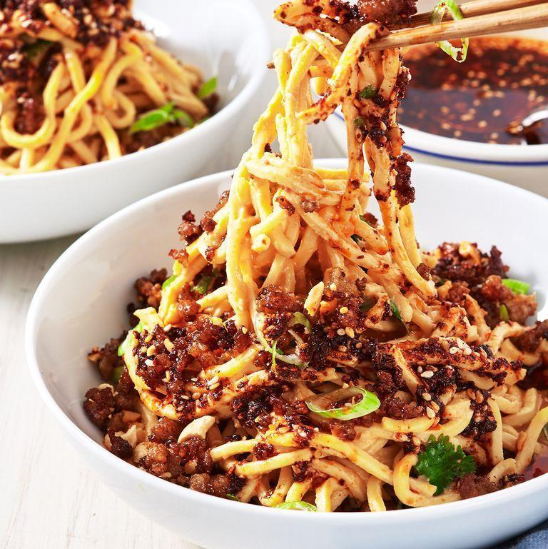 "<p>Noodles coated in a sauce of tahini, soy sauce, garlic, ginger and Chinese black vinegar, then drizzled with chile oil, will be your next dinner party hit.</p><p><em><a href=""https://www.delish.com/cooking/recipe-ideas/a26555663/dan-dan-noodles-recipe/"" rel=""nofollow noopener"" target=""_blank"" data-ylk=""slk:Get the recipe from Delish »"" class=""link rapid-noclick-resp"">Get the recipe from Delish »</a></em></p>"
