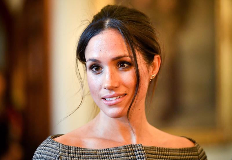 Meghan Markle suffers wardrobe malfunction as she flashes bra at wedding