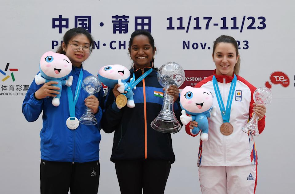 Gold medalist Elavenil Valarivan C of India, silver medalist Lin Ying-Shin L of Chinese Taipei and bronze medalist Laura-Georgeta Coman of Romania pose for photos during the awarding ceremony of the women's 10m air rifle final at the ISSF World Cup Final in Putian, southeast China's Fujian Province, Nov. 21, 2019. (Photo by Lin Shanchuan/Xinhua via Getty)