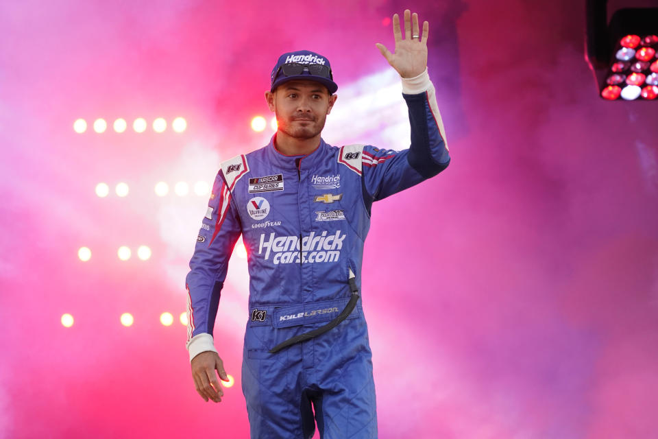 Kyle Larson (5) waves to the crowd during driver introductions prior to the start of the NASCAR Cup series auto race in Richmond, Va., Saturday, Sept. 11, 2021. (AP Photo/Steve Helber)