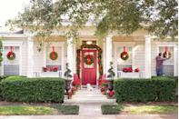 "<p>A Christmas porch crafted by <a href=""https://ashleybrookedesigns.com/"" rel=""nofollow noopener"" target=""_blank"" data-ylk=""slk:Ashley Brooke Designs"" class=""link rapid-noclick-resp"">Ashley Brooke Designs</a> weaves pinecones and poinsettias into her classic unadorned garland. Wreaths hanging from the windows lend a uniform feel.</p>"