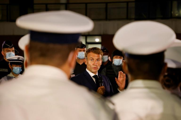 Macron has promised extra police officers and magistrates for the city (AFP/Ludovic MARIN)