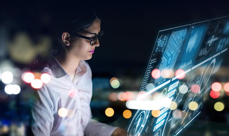 A woman examines business data.