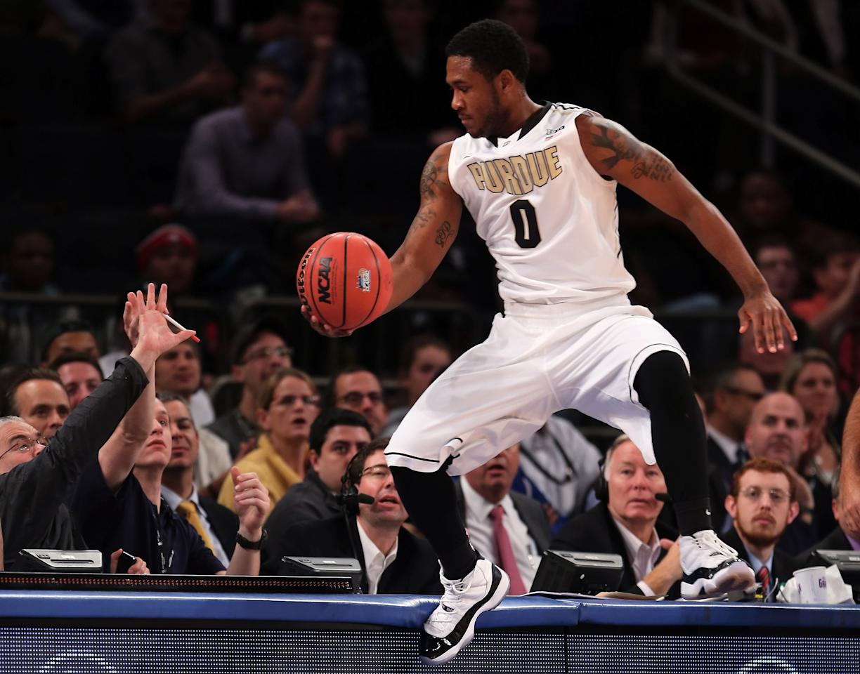 NEW YORK, NY - NOVEMBER 15:  Terone Johnson #0 of the Purdue Boilermakers keeps the ball in bounds but runs into the scorer's table in the first half against the Villanova Wildcats during the 2012 2K Sports Classic on November 15, 2012 at Madison Square Garden in New York City.  (Photo by Elsa/Getty Images)