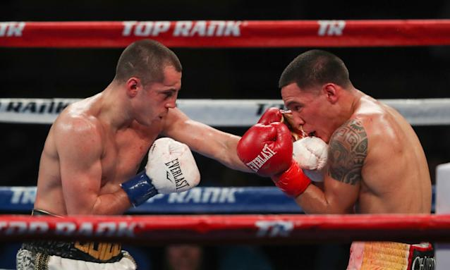 Scott Quigg lands a punch on the jaw of Oscar Valdez Jr but Quigg lost in Los Angeles.
