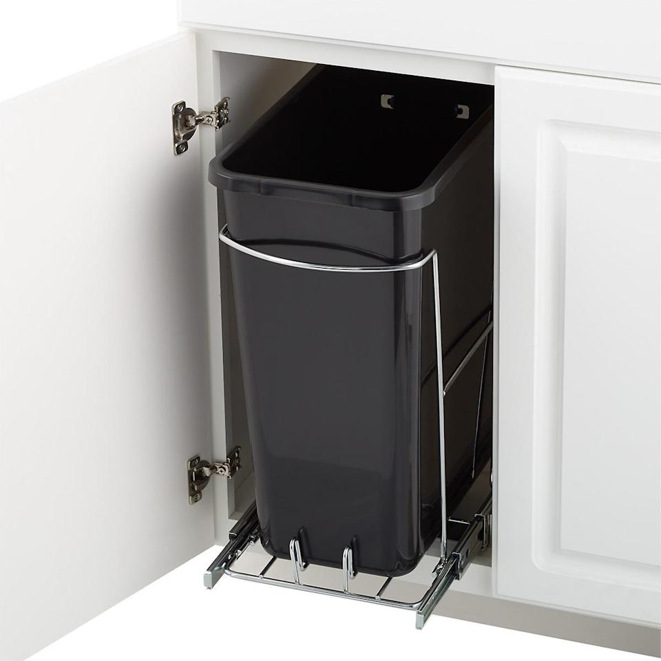 """<p>No pantry or closet in your kitchen to place a trashcan? No problem. This polished steel frame holds an eight-gallon trash bag and glides out from a cabinet up to 18 inches tall—so you can conceal your garbage, recyclables, or compost <a href=""""https://www.marthastewart.com/7975856/diy-sink-skirt"""" rel=""""nofollow noopener"""" target=""""_blank"""" data-ylk=""""slk:right under your sink"""" class=""""link rapid-noclick-resp"""">right under your sink</a>.</p> <p><strong><em>Shop Now: </em></strong><em>The Container Store Eight Gallon Pull-Out Trash Can, $49</em><em>, <a href=""""https://click.linksynergy.com/deeplink?id=93xLBvPhAeE&mid=37353&murl=https%3A%2F%2Fwww.containerstore.com%2Fs%2F8-gal.-pull_out-trash-can%2Fd%3Fq%3Dkitchen%2Btrash%2Bcan%26amp%3BproductId%3D11007623&u1=MSLTheseEfficientSleekTrashCansWillUpgradeYourKitchenameyerKitGal7984490202009I"""" rel=""""nofollow noopener"""" target=""""_blank"""" data-ylk=""""slk:containerstore.com"""" class=""""link rapid-noclick-resp"""">containerstore.com</a></em><em>. </em></p>"""