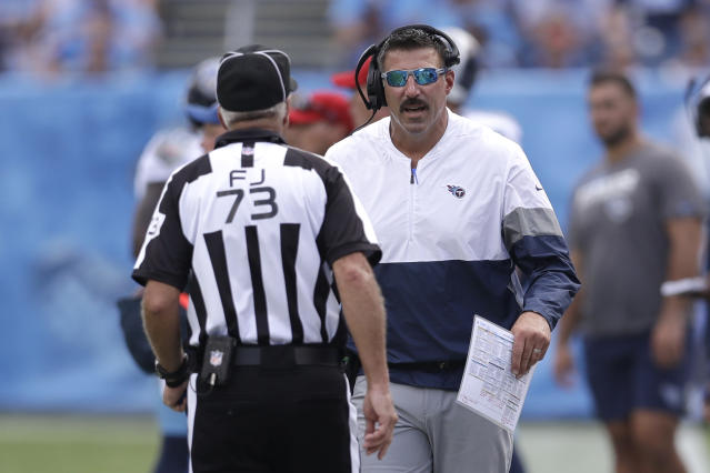 Tennessee Titans head coach Mike Vrabel talks with field judge Joe Larrew (73) in the first half of an NFL football game against the Indianapolis Colts Sunday, Sept. 15, 2019, in Nashville, Tenn. (AP Photo/James Kenney)