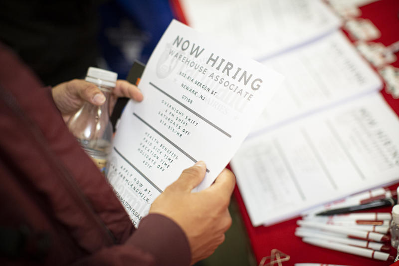 ELIZABETH, NJ - NOVEMBER 08: A man holds a flyer with job opening information at a Farmland during a Port Authority Of New York And New Jersey job fair at the Union County College on November 8, 2019 in Elizabeth, New Jersey. (Photo by Kena Betancur/Getty Images)