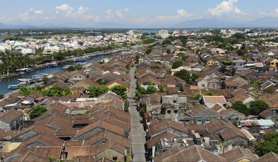 This aerial photo shows quiet streets during social distancing in Hoi An, Vietnam, Friday, July 31, 2020. The old town, Vietnam's top tourist attraction, starts two weeks of social distancing on Friday morning in an attempt to contain the spread of the coronavirus. (AP Photo/Hieu Dinh)