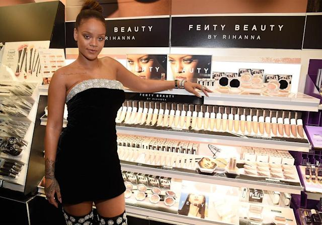 Rihanna with a display of her namesake makeup line, Fenty Beauty. (Photo: Getty Images)