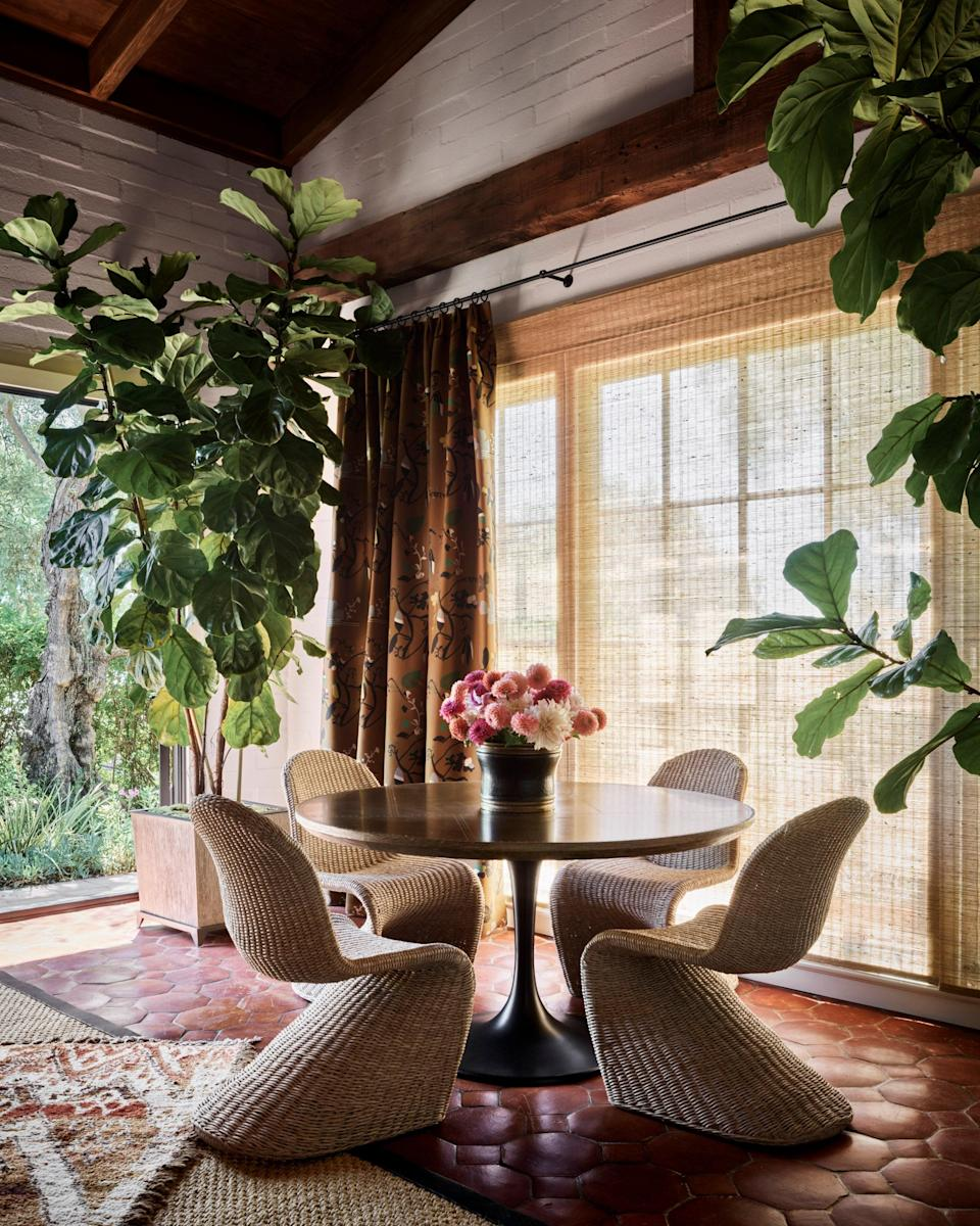 At the opposite end of the living room from the bookcase, an intimate seating area looks to the garden.