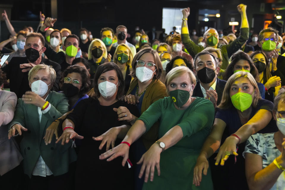 Members and supporters of the Green Party (Die Gruenen) gesture at the Green Party event after the close of polling stations during German parliament election, in Berlin, Germany, on Sunday, Sept. 26, 2021. (AP Photo/Matthias Schrader)