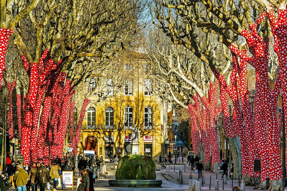 """<p><strong>Aix-en-Provence, France</strong></p><p>Most people think of Paris as the go-to city in France, but if you're interested in exploring the best of the country's wine, food, and culture, Aix-en-Provence is a worthwhile visit. It's an easy train ride from Paris or Marseille, and has lots of museums, cafes, and historical sites <em>sans</em> the heavy tourism. If you're feeling ambitious, it's also a quick drive to massive ancient Roman aqueduct Pont du Gard, the medieval walled city of Avignon, and wine mecca Chateauneuf-du-Pape. The latter will feel like a bucket list achievement in itself when the iconic wine cellars offer you free tastings, or """"degustations"""" in French.</p><span class=""""copyright"""">Photo: Norbert Scanella / Alamy. </span>"""