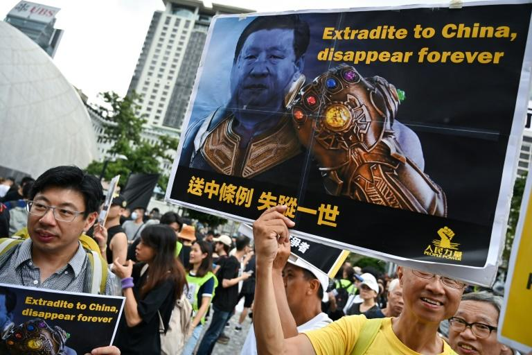 Protesters gather for a new rally in Hong Kong which will end at a station that links the territory to mainland China (AFP Photo/Hector RETAMAL)