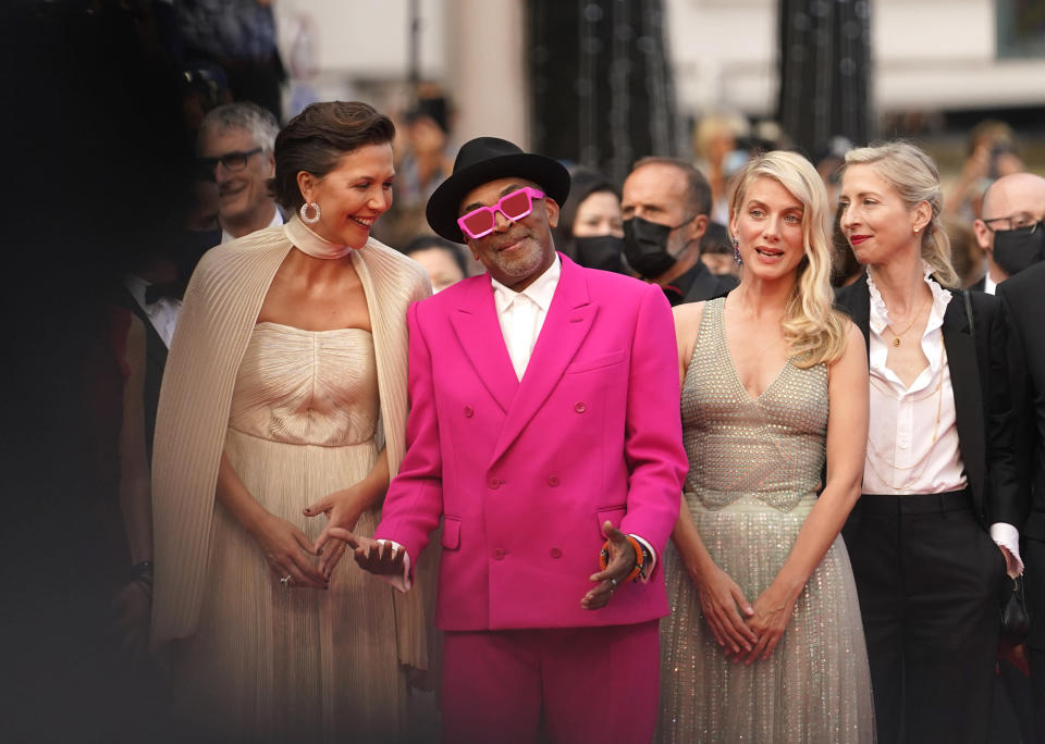Jury president Spike Lee, second from left, poses with jury members Maggie Gyllenhaal, from left, Melanie Laurent and Jessica Hausner at the premiere of the film 'Annette' and the opening ceremony of the 74th international film festival, Cannes, southern France, Tuesday, July 6, 2021. (AP Photo/Brynn Anderson)