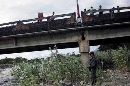 A Venezuelan National Guard keeps watch next to the Simon Bolivar international bridge in San Antonio del Tachira