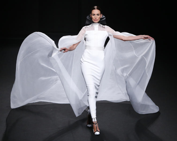 A model wears a creation by French fashion Stephane Rolland's Haute Couture Fall-Winter 2013-2014 collection presented Tuesday, July 2, 2013 in Paris. (AP Photo/Francois Mori)