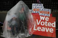 """FILE - In this Tuesday, March 12, 2019 file photo a Pro-Brexit leave the European Union supporter takes part in a protest outside the Houses of Parliament in London. It's more than four years since Britain voted to leave the European Union, and almost a year since Prime Minister Boris Johnson won an election by vowing to """"get Brexit done."""" Spoiler alert: It is not done. As negotiators from the two sides hunker down for their final weeks of talks on an elusive trade agreement, Britain and the EU still don't know whether they will begin 2021 with an organized partnership or a messy rivalry.(AP Photo/Frank Augstein, File)"""
