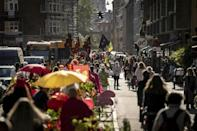 The area has changed in many ways: tourists weave through its cobblestone roads, and the once-reviled market economy is in full swing (AFP/Mads Claus Rasmussen)