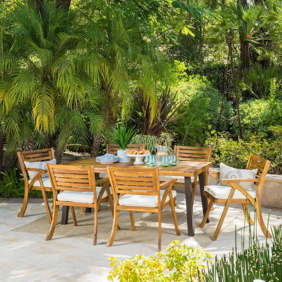 <p>What's there not to love about the <span>Della-Hermosa Acacia Wood Dining Set</span> ($835)?</p>