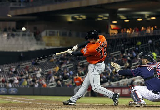 Miami Marlins catcher Rob Brantly (19) hits an RBI double against Minnesota Twins starting pitcher Mike Pelfrey (37) during the fifth inning in the second baseball game of a doubleheader Tuesday, April 23, 2013, in Minneapolis. (AP Photo/Genevieve Ross)