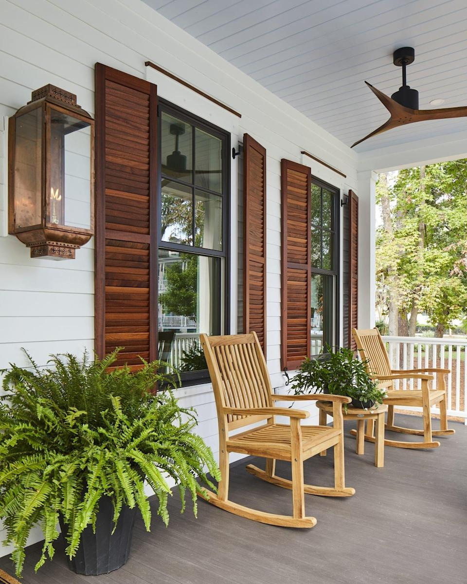 front porch with rocking chairs on porch of house in Habersham southern living inspired community