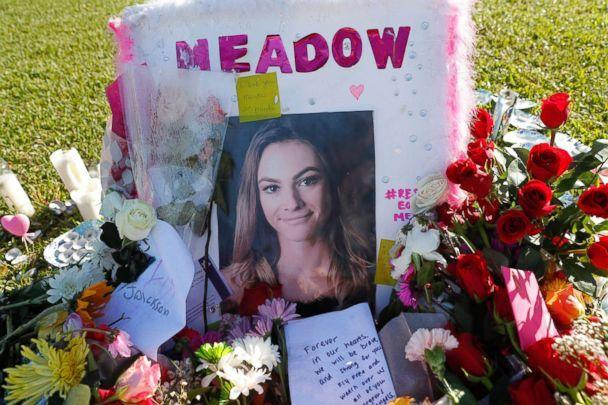 PHOTO: A photo of Meadow Pollack, one of the seventeen victims who was killed in the shooting at Marjory Stoneman Douglas High School, sits against a cross as part of a public memorial, in Parkland, Fla., Feb. 17, 2018. (Gerald Herbert/AP)