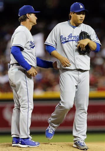 Los Angeles Dodgers manager Don Mattingly, left, pulls Hyun-jin Ryu, of South Korea, from a baseball game during the seventh inning against the Arizona Diamondbacks, Saturday, April 13, 2013, in Phoenix. (AP Photo/Matt York)