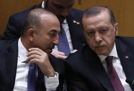 FILE PHOTO - President Erdogan of Turkey speaks with his Foreign Minister Cavusoglu during the 71st United Nations General Assembly in New York