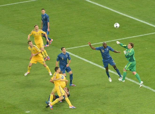 Ukrainian goalkeeper Andriy Pyatov (R) fists the ball away during the Euro 2012 championships football match Ukraine vs France on June 15, 2012 at the Donbass Arena in Donetsk. AFP PHOTO / SERGEI SUPINSKYSERGEI SUPINSKY/AFP/GettyImages