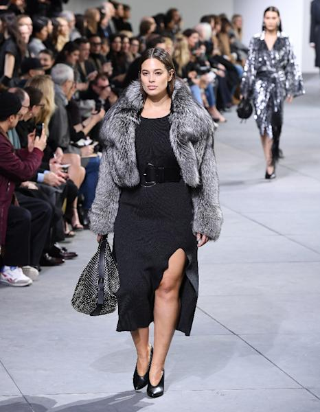 Ashley Graham, became the first plus-size model to walk on the New York runway for Michael Kors, who unveiled a collection full of opulent fur coats and monochrome looks (AFP Photo/Angela Weiss)