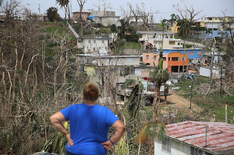 Irma Santiago surveys her in Corozal neighborhood as Puerto Ricans deal with the aftermath of Hurricane Maria on Wednesday. (Joe Raedle via Getty Images)
