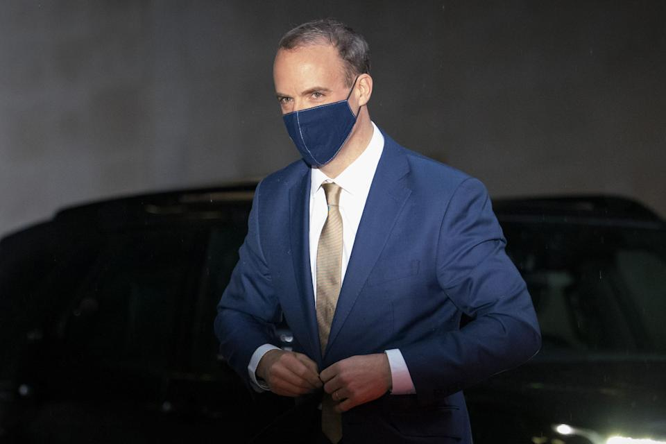 Britain's Foreign Secretary Dominic Raab wearing a protective face covering to combat the spread of the coronavirus, arrives at the BBC in central London on December 13, 2020, to appear on the BBC political programme The Andrew Marr Show. - Sunday is just the latest in a string of supposedly hard deadlines for the negotiations but, with Britain due to leave the EU single market in 19 days, tensions are rising. (Photo by Tolga Akmen / AFP) (Photo by TOLGA AKMEN/AFP via Getty Images)