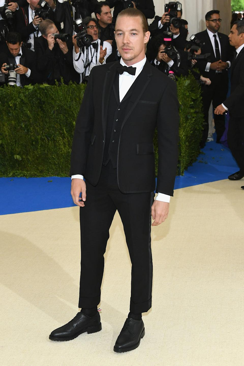 """<h1 class=""""title"""">Diplo in Thom Browne</h1><cite class=""""credit"""">Photo: Getty Images</cite>"""