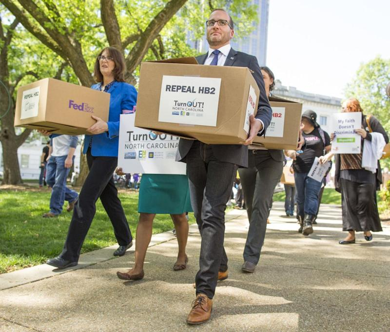 Chad Griffin and supporters carry boxes of petitions