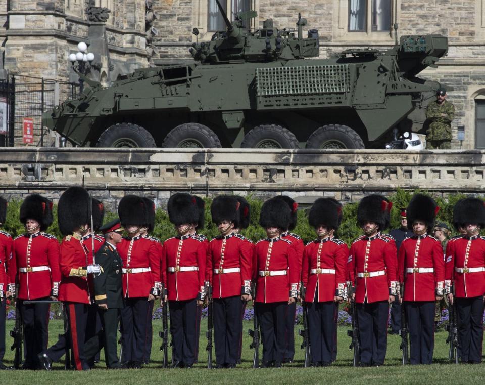 The former chief of defence staff inspects the troops