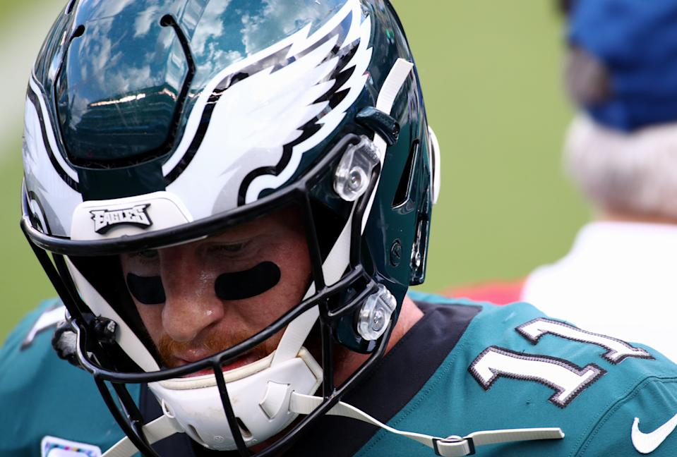 Carson Wentz looks down during a game.