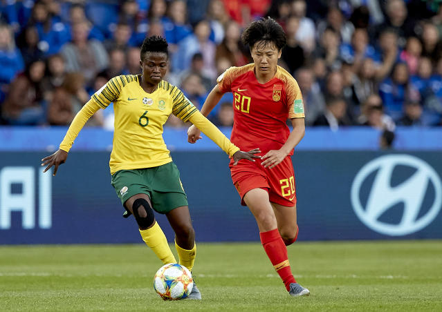 Mamello Makhabane of South Africa competes for the ball with Zhang Rui of China PR during the 2019 FIFA Women's World Cup France group B match between South Africa and China PR at Parc des Princes on June 13, 2019 in Paris, France. (Photo by Quality Sport Images/Getty Images)