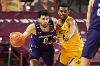 Northwestern's Boo Buie (0) drives as Minnesota's Jamal Mashburn Jr. (4) defends in the second half of an NCAA college basketball game, Thursday, Feb. 25, 2021, in Minneapolis. (AP Photo/Jim Mone)