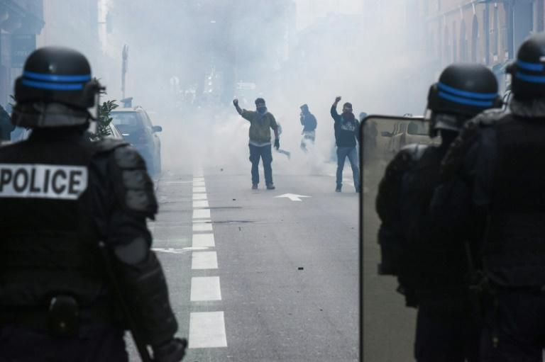 Police face protesters in Toulouse on Thursday, when around 200 high schools were blocked by fresh demonstrations