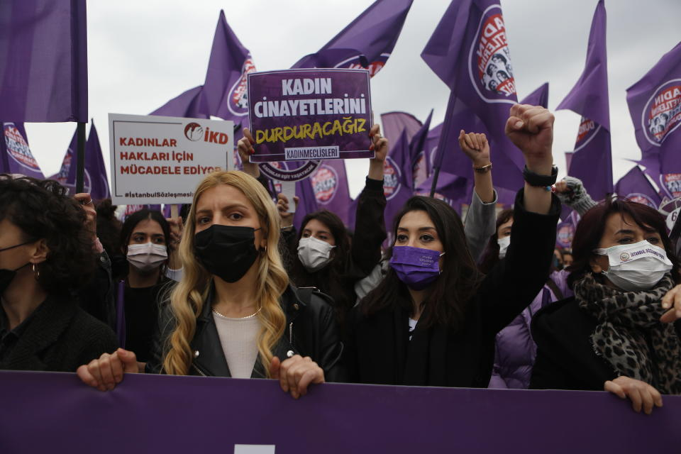 Protesters chant slogans during a rally in Istanbul, Saturday, March 20, 2021. Turkey's President Recep Tayyip Erdogan's overnight decree annulling Turkey's ratification of the Istanbul Convention is a blow to women's rights advocates, who say the agreement is crucial to combating domestic violence. Turkey was the first country to sign 10 years ago and that bears the name of its largest city. (AP Photo/Mehmet Guzel)